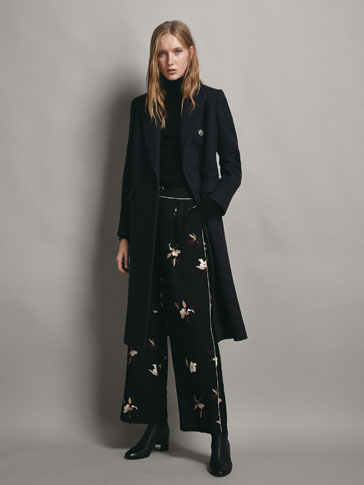 FLORAL PRINT TROUSERS WITH CONTRAST PIPING