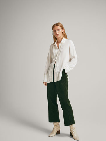 SHIRT WITH RUFFLES AND PLEATS
