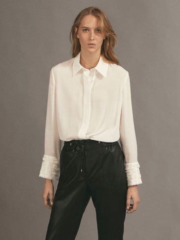 SHIRT WITH FRINGED TRIMS