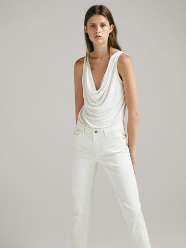 DRAPED TOP WITH TIE DETAIL IN THE BACK
