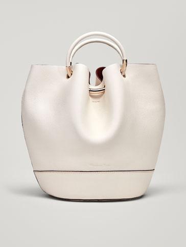حقيبة جلدية بزينة معدنية