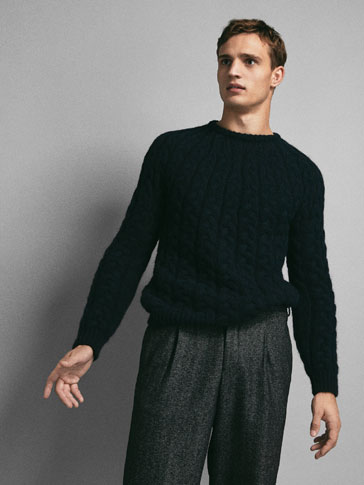 LIMITED EDITION CABLE-KNIT SWEATER