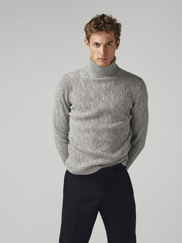 LIMITED EDITION WOOL CABLE-KNIT SWEATER