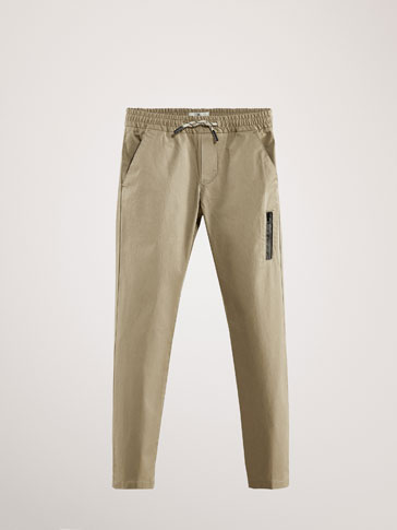 SLIM FIT COTTON TROUSERS WITH THERMO-SEALED DETAIL