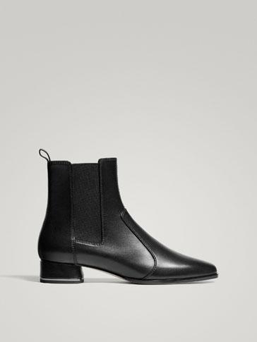 حذاء صاعد مطاطي جلد أسود