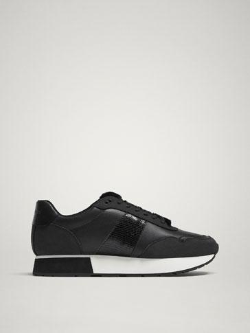 حذاء رياضي جلد أسود