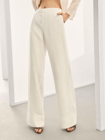 LIMITED EDITION TROUSERS WITH TURN-UP HEM DETAIL