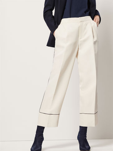 CROPPED TROUSERS WITH CONTRASTING PIPED SEAMS