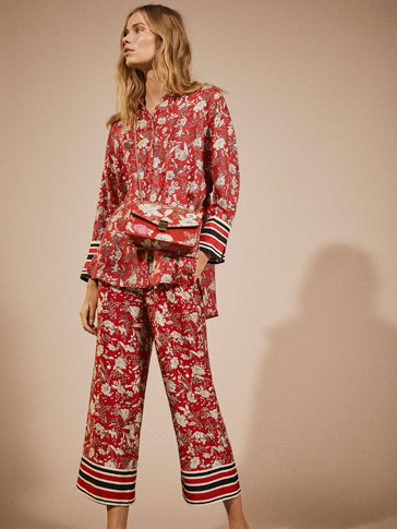 FLORAL PRINT TROUSERS WITH STRIPE DETAIL