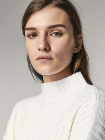 CAPE-STYLE CABLE-KNIT SWEATER