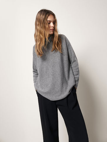 RIBBED CAPE-STYLE WOOL SWEATER