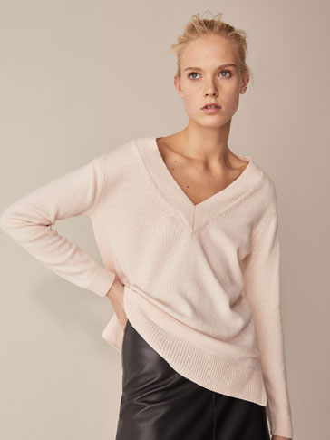 WOOL SWEATER WITH VENT DETAILS