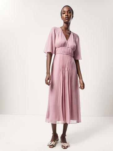 FLOWING DRESS WITH PLEATED DETAILS