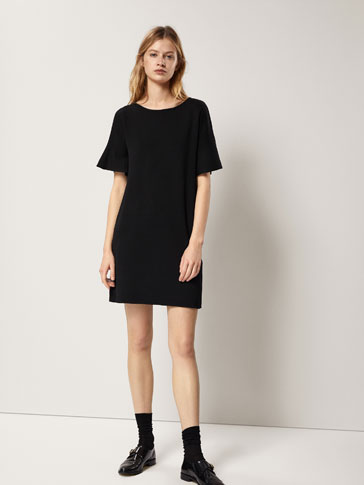 KNIT DRESS WITH A FLARED DETAIL