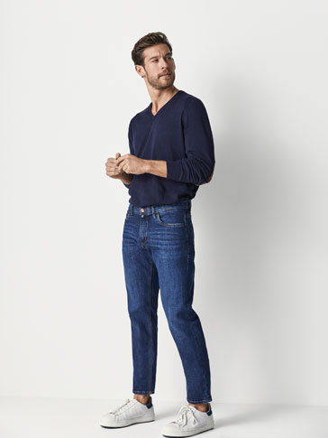 PANTALONI IN JEANS STONE WASHED DAMAGES SLIM FIT