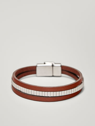 TRIPLE BRACELET WITH A METALLIC STRAP
