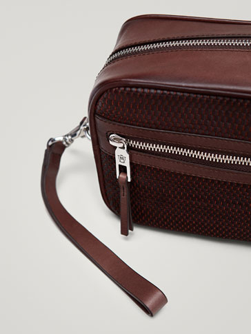 LEATHER TOILETRY BAG WITH PLAITED PANEL