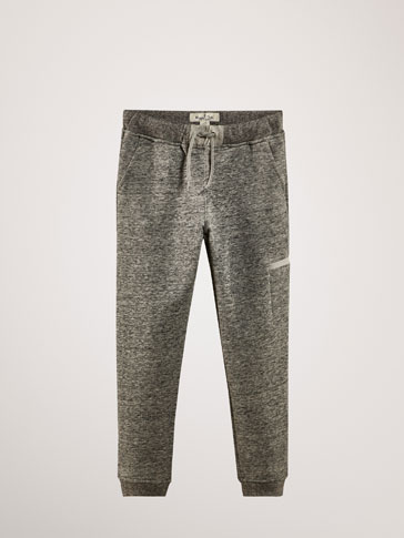 FLECKED TROUSERS WITH CARGO DETAIL