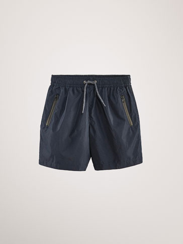 TECHNICAL SWIMMING TRUNKS WITH THERMO-SEALED DETAIL