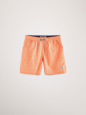ZIGZAG PRINT SWIMMING TRUNKS WITH THERMO-SEALED DETAIL