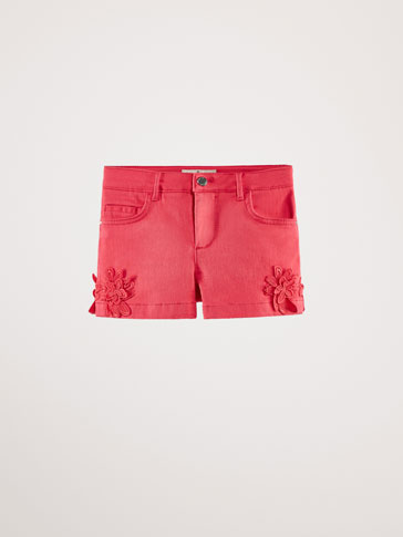 SHORTS WITH FLORAL TRIMS