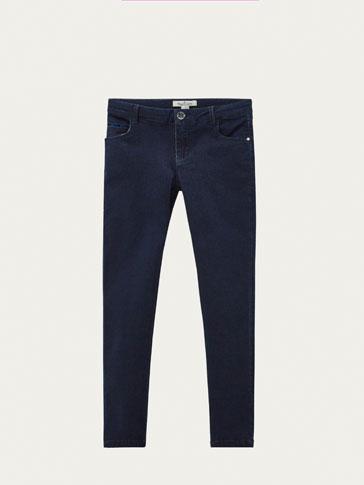 سروال جينز تفصيل مخمل سليم فيت