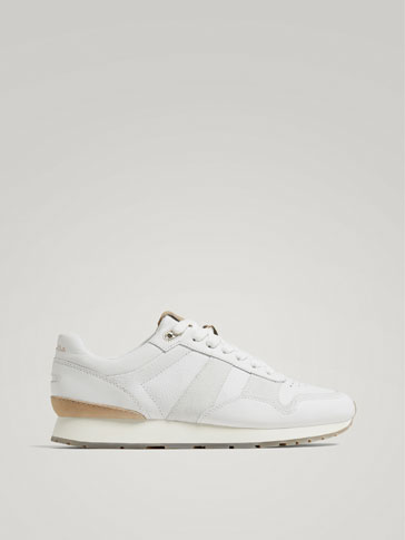 حذاء رياضي جلدي أبيض