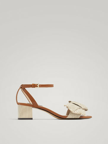 LEATHER SANDALS WITH RAFFIA BOW