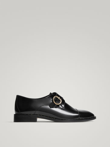 حذاء إبزيم جلد أسود