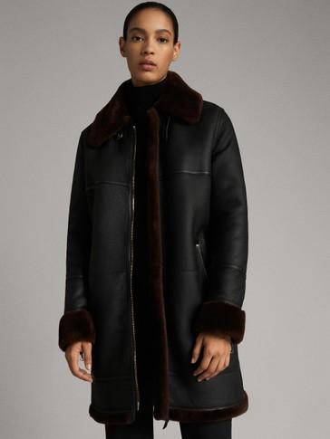 معطف أسود من الجلد و فرو الخروف