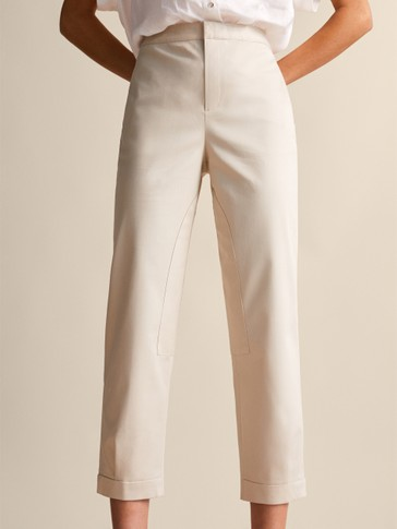 SLIM FIT TROUSERS WITH BUTTON DETAIL