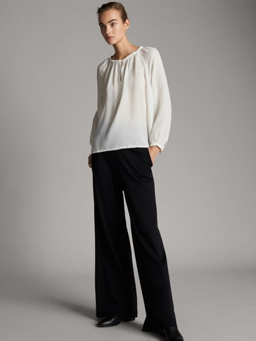 FLOWING BLOUSE WITH SLEEVE DETAIL