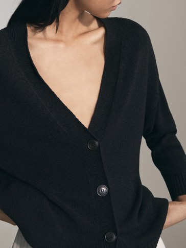 KNITTED CARDIGAN WITH V-NECK DETAIL