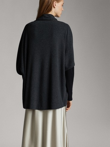 CAPE WITH LEATHER PIPING DETAIL