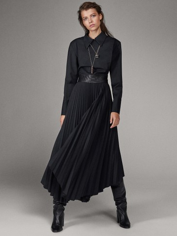LIMITED EDITION BLACK DRESS WITH PLEATED SKIRT