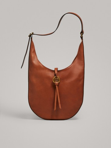 NAPPA LEATHER SHOULDER BAG WITH METAL APPLIQUÉ