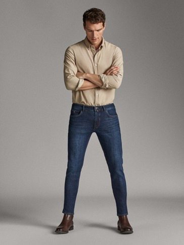 PANTALÓN VAQUERO STONE WASH SLIM FIT