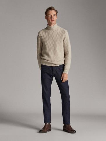 بنطلون جينز بطرف سفلي مطوي إصدار محدود