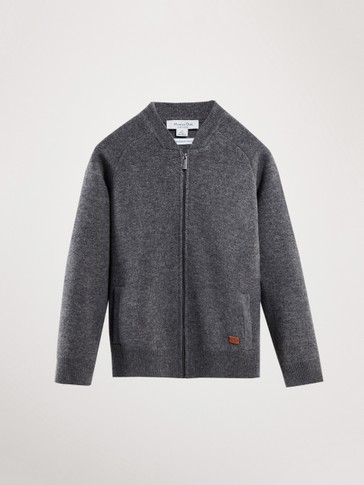 100% WOOL ZIPPED CARDIGAN