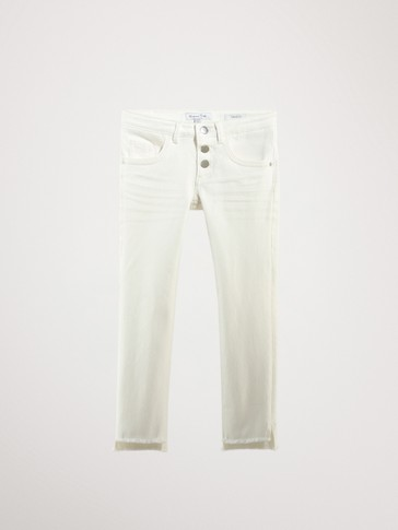 CASUAL FIT JEANS WITH FRAYED HEMS