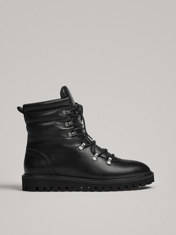 BLACK APRÈS-SKI QUILTED FLAT ANKLE BOOTS