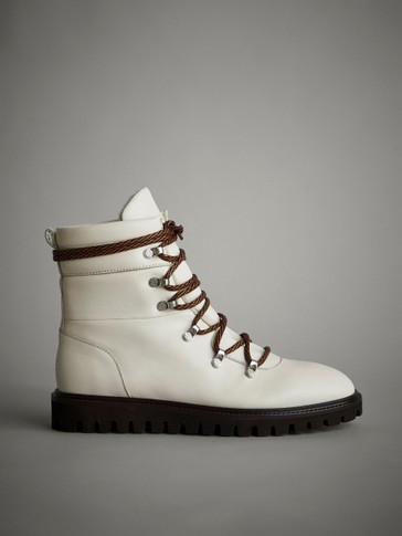 WHITE APRÈS-SKI QUILTED FLAT ANKLE BOOTS