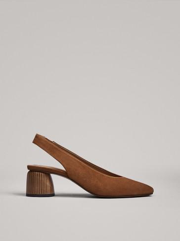 حذاء بكعب خشبي