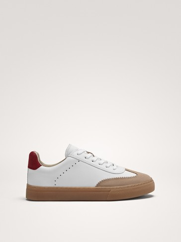 WHITE PLIMSOLLS WITH COLOURED SOLE