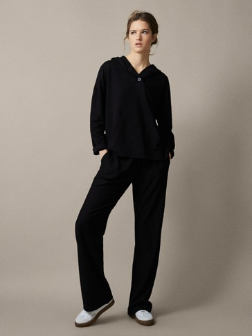 TEXTURED BLACK WIDE FIT TROUSERS