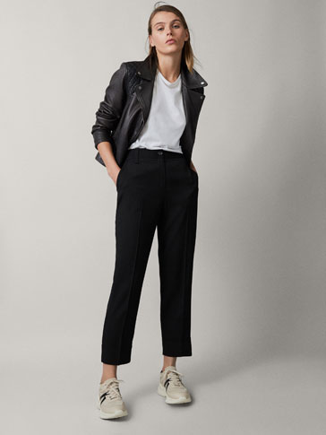 TAPERED BLACK TROUSERS WITH TURN-UP HEMS