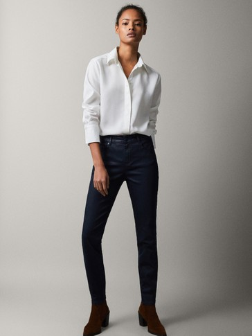 MID-RISE SKINNY FIT RUBBERISED TROUSERS