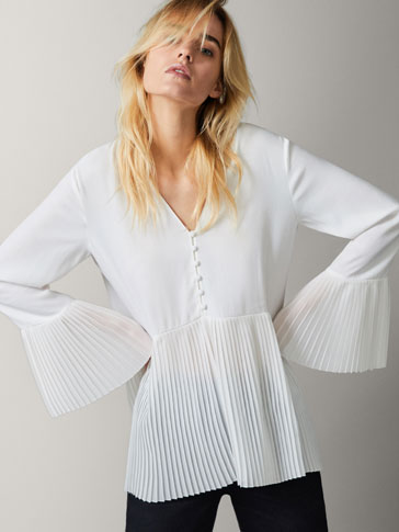 OVERSIZED BLOUSE WITH PLEATED HEM