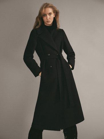 Vestido negro con chaqueta de punto