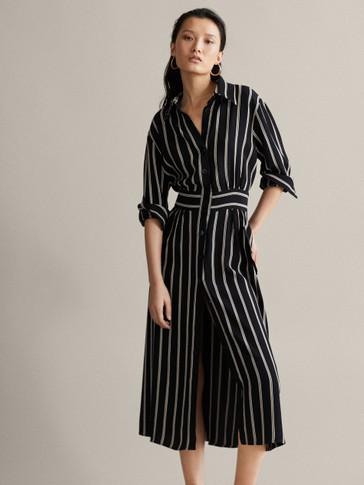 Vestido negro con blanco combinacion